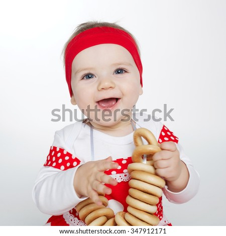 photo of little girl with bread-rings - stock photo