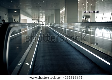 Photo of long horizontal escalator at international airport terminal - stock photo