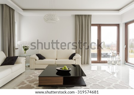 Photo of luxurious leather sofa and small wooden table - stock photo