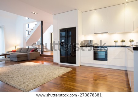Photo of luxury kitchen with modern living room - stock photo