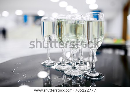 Photo of luxury wine glasses on the black table and white background