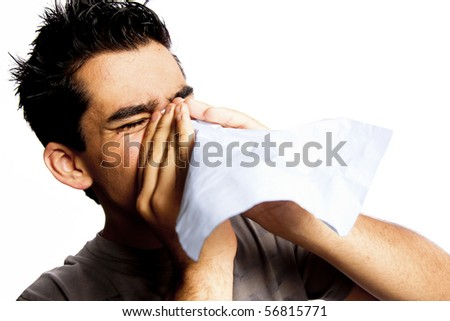 photo of man blowing his nose - stock photo