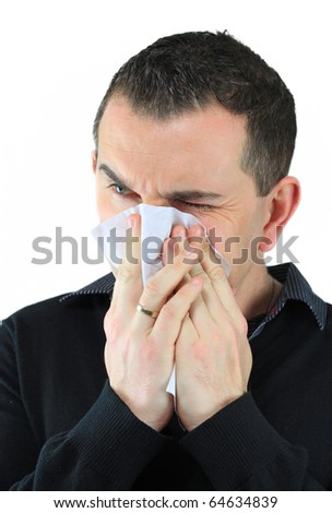 Photo of man blowing his nose