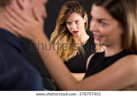 Photo of man cheating on jealous wife - stock photo