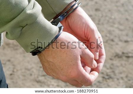 Photo of man handcuffed criminal police - stock photo