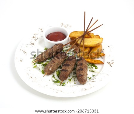 Photo of meat with potatoes on a plate - stock photo
