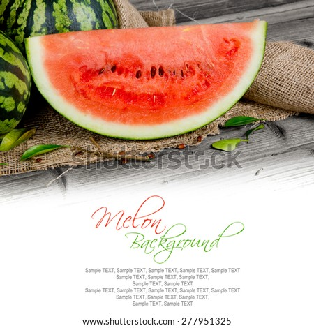 Photo of melon with slice and leaves on burlap with white space - stock photo