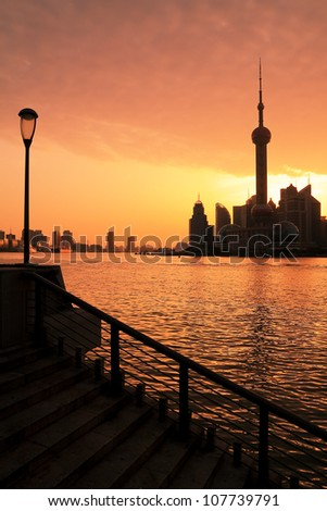Photo of modern buildings by Huangpu river at dawn Pudong Lujiazui Skyline Shanghai, China