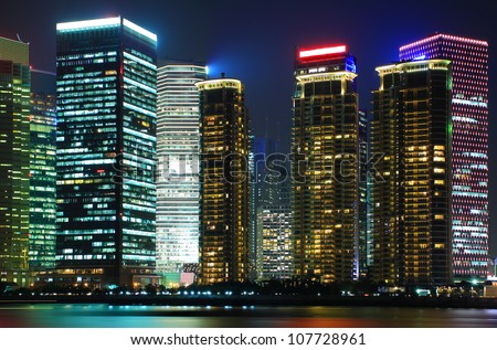 Photo of modern buildings by Huangpu river at night Pudong Lujiazui Skyline Shanghai, China