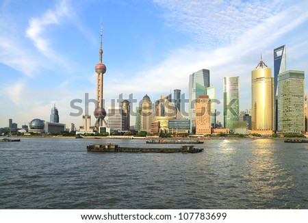 Photo of modern buildings by Huangpu river at Pudong Lujiazui Skyline Shanghai, China - stock photo