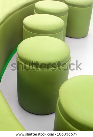 Photo of modern, comfortable, cushy and stylish stools for meeting rooms at office or living rooms at homes made with imitation leather in green color - stock photo