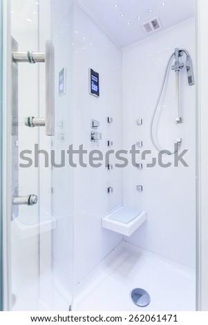 Photo of modern white shower in new luxury bathroom - stock photo