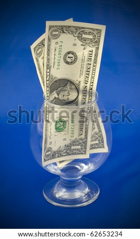 Photo of money in a wine glass