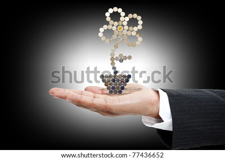 photo of money tree made of coins - stock photo
