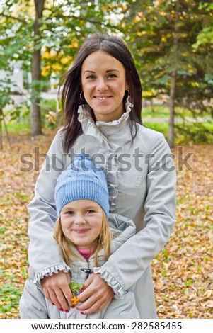 Photo of mother and daughter in autumn