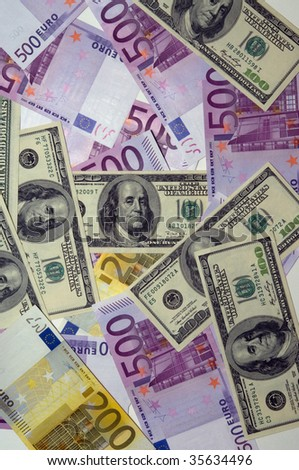 Photo of multicurrency background from dollars and euros - stock photo