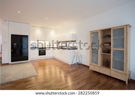 Photo of new exclusive kitchen open on living room - stock photo