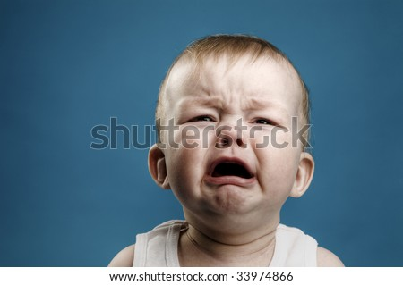 Photo of nine month baby crying, isolated - stock photo