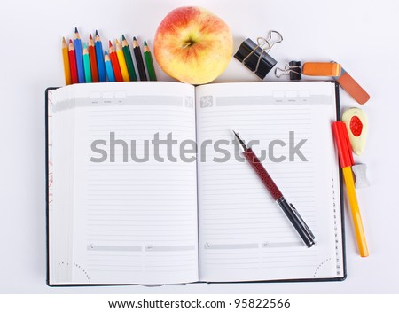 Photo of office and student gear over white background - stock photo