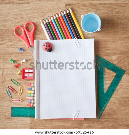 Photo of office and student gear over wood background - stock photo