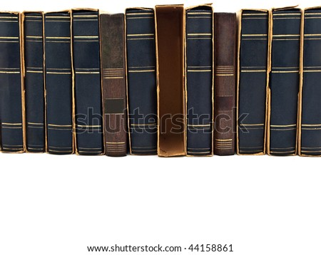 Photo of old book row at white with copyspace - stock photo