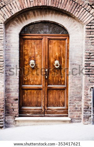 photo of Old destroyed door to the Tuscan home - stock photo
