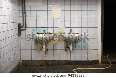 Photo of Old sinks in a public toilets - stock photo