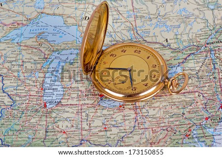 Photo of old watch on map - stock photo