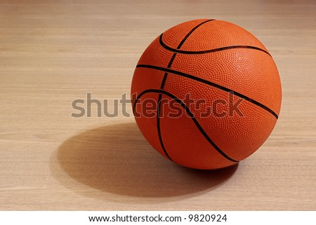 Photo of one basket ball in a wooden floor - stock photo