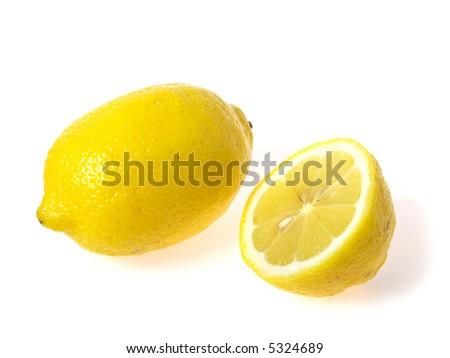 Photo of one lemon and half on white background - stock photo