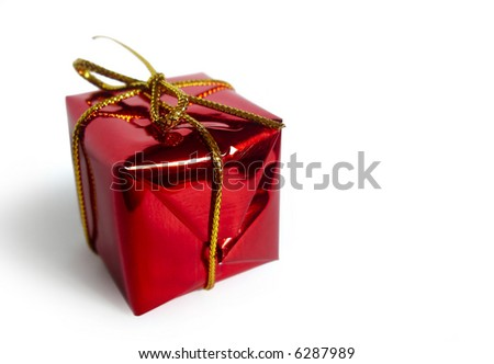 Photo of one red little christmas gift isolated in white background