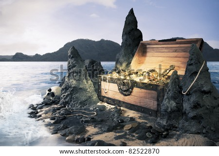photo of open treasure chest with shinny gold - stock photo
