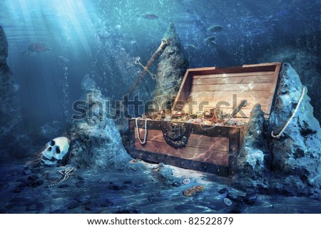 photo of open treasure chest with shinny gold underwater - stock photo