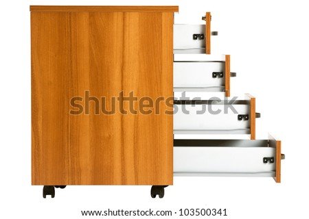 Photo of opened drawers from wooden cabinet - stock photo