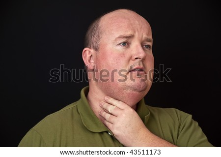 photo of overweight male with a sore throat - stock photo