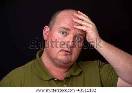 photo of overweight male with heavy thoughts on his mind - stock photo