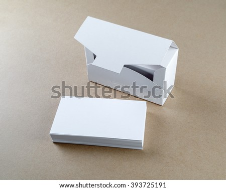 Photo of packing box with blank business cards and a stack of business cards.  Blank mock-up for design presentations and portfolios.