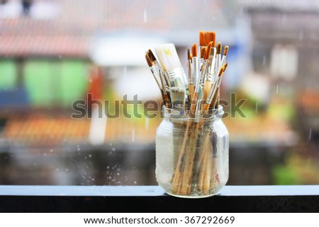 Photo of paint brushes in a jar