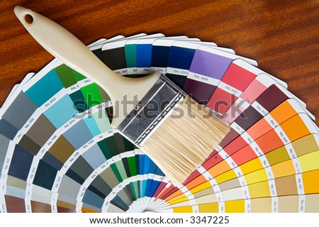 photo of Paintbrush with card of colors - stock photo