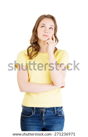Photo of pensive young student woman. - stock photo