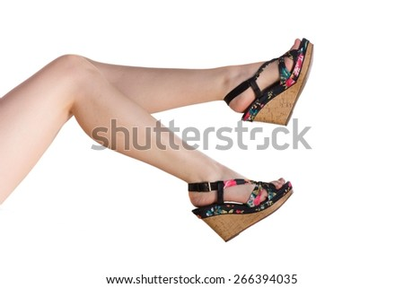 Photo of perfect female legs wearing high heels isolated on white background - stock photo
