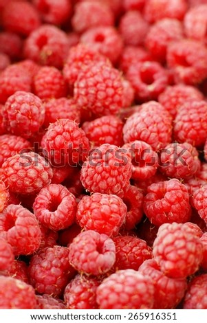 Photo of pile of red raspberries may be used as a background
