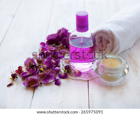Photo of pink spa background, picture of zen candle light, image of fresh soft towel on wooden table, bath accessories, aromatherapy.luxury spa resort - stock photo