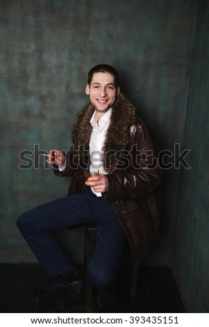 photo of portrait of handsome man in fur coat with cigarette