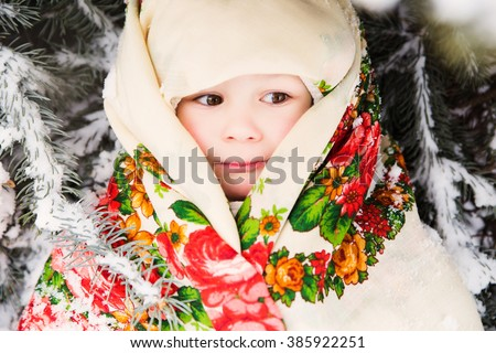 photo of portrait of small slavic girl in national scarf - stock photo