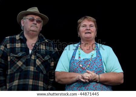 photo of portrait senior male and female on black - stock photo