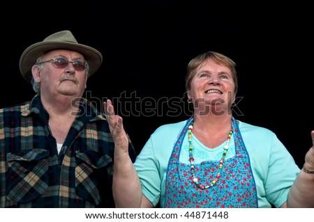 photo of portrait senior male and female on black - stock photo