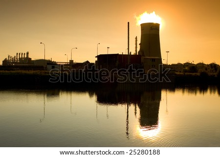 Photo of power plant at sunset. Industrial structure landscape