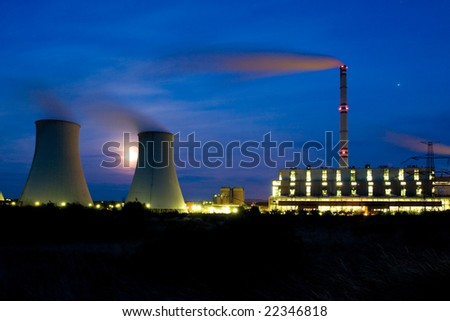 Photo of power plant in the night. Industrial structure landscape
