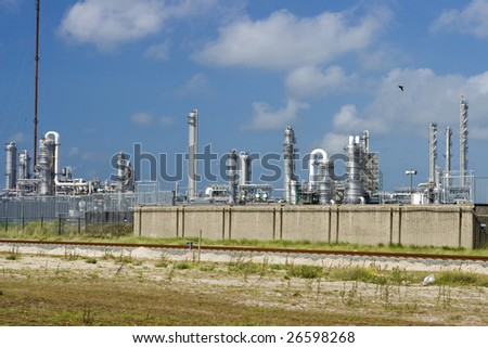 Photo of power plant with cloudy sky
